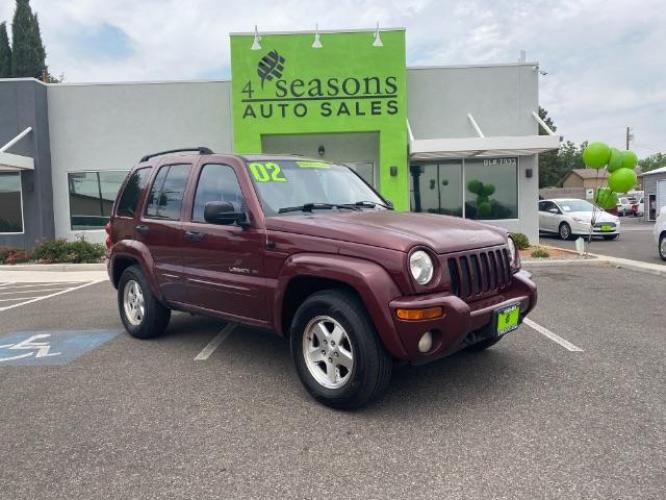 2002 Maroon /Dark Slate Gray Cloth Interior Jeep Liberty Limited 4WD (1J8GL58K42W) with an 3.7L V6 SOHC 12V engine, 4-Speed Automatic transmission, located at 1865 East Red Hills Pkwy, St. George, UT, 84770, (435) 628-0023, 37.120850, -113.543640 - Photo #0