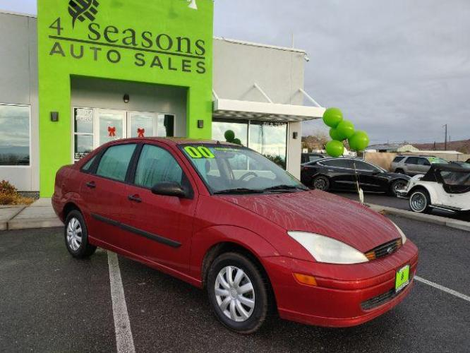 2000 Sangria Red Clearcoat Metallic /Medium Graphite Cloth Ford Focus LX (1FAFP33P8YW) with an 2.0L L4 SOHC 8V engine, located at 1865 East Red Hills Pkwy, St. George, UT, 84770, (435) 628-0023, 37.120850, -113.543640 - Photo #0