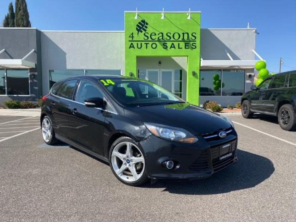 2014 Tuxedo Black Metallic /Charcoal Black Ford Focus Titanium Hatch (1FADP3N26EL) with an 2.0L L4 DOHC 16V engine, located at 1865 East Red Hills Pkwy, St. George, UT, 84770, (435) 628-0023, 37.120850, -113.543640 - Photo #0