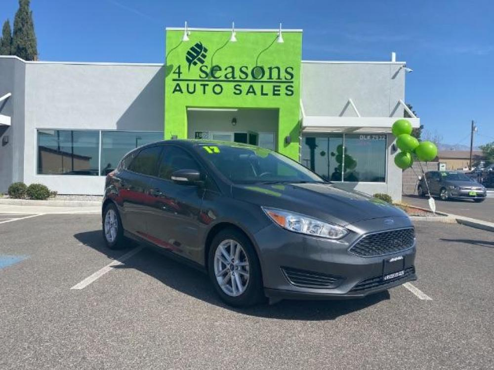 2017 Magnetic Metallic /Medium Light Stone, cloth Ford Focus SE Hatch (1FADP3K23HL) with an 2.0L L4 DOHC 16V engine, 6-Speed Automatic transmission, located at 1865 East Red Hills Pkwy, St. George, UT, 84770, (435) 628-0023, 37.120850, -113.543640 - Photo #0